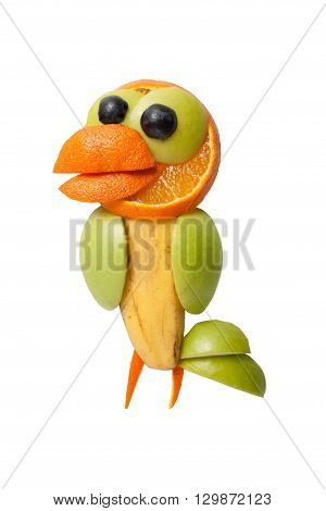 Bird in funny pose made of fresh fruits
