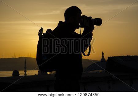Photographers take pictures at sunrise silhouette image the first light in the morning.