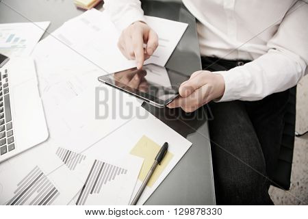 Investment manager working process.Photo trader work modern tablet.Touching electronic device.Graphic, stock exchange rating, reports document table.Business project startup.Horizontal, film effect.