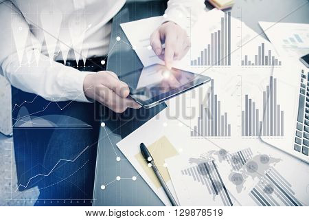 Banker manager working process.Photo analyst trader work market graphs.Using electronic device.Graphic icons, worldwide online stock exchanges interfaces on screen.Business project startup.Film effect.