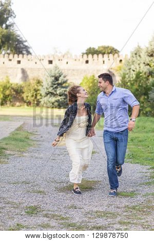 Beautiful happy smiling running couple outdoors. nature