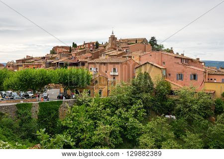 ROUSSILLON FRANCE - MAY 03 2015: View on the beautiful medieval village of Roussillon. It ochre village is included in list of