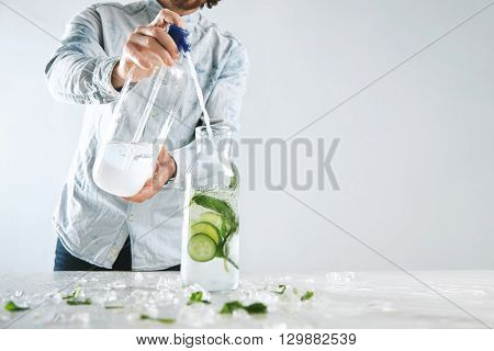 Bartender Pours Sparkling Water In Vintage Bottle With Ice, Cucumber And Mint From Siphone To Make C