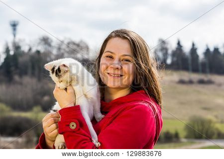 Young Woman With Pets In The Garden