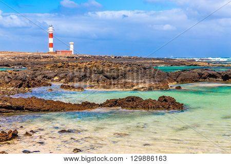 Toston Lighthouse And Rocky Seashore - El Cotillo Fuerteventura Canary Islands Spain