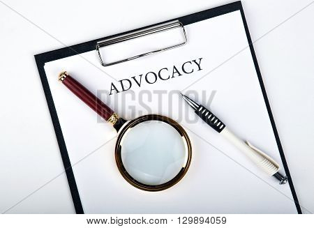 document with the title of advocacy with pen loupe close up