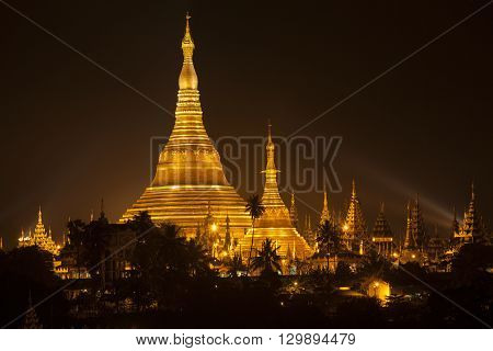 Shwedagon Pagoda also known in English as the Great Dagon Pagoda and the Golden Pagoda is a 99 metres (325 ft)[citation needed] gilded pagoda and stupa located in Yangon Burma. The pagoda lies to the west of Kandawgyi Lake on Singuttara Hill thus dominati