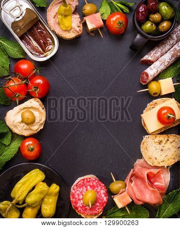 Spanish Tapas On A Black Stone Background