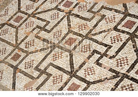 Mosaic floor of ancient roman villa with ancient geometrical ornament including fyflot symbol archaeological park Tombs of Kings,Paphos,Cyprus, unesco heritage