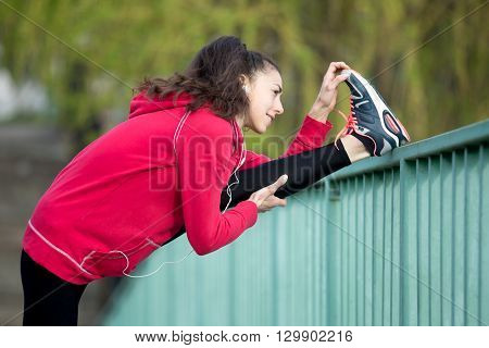 Runner Woman Doing Hamstring Stretch After Jogging