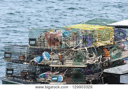 Lobster traps stacked on stern of boat