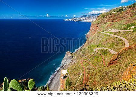 winding road goes down to the beach Ponta do Garajau Madeira Portugal