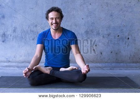 Mexican yoga teacher meditating