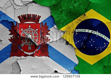 flags of Rio de Janeiro and Brazil painted on cracked wall