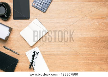 Topview of office table with various items on its left side. Mock up