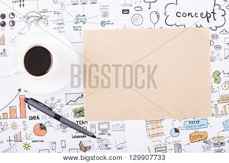 Top view of desktop with blank brown paper coffee cup pen and business sketch. Mock up