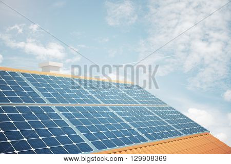 Side view of solar panels on house roof against bright blue sky. 3D Rendering