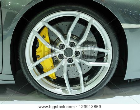 Super car disc brake. Car wheels. steel alloy car disks background