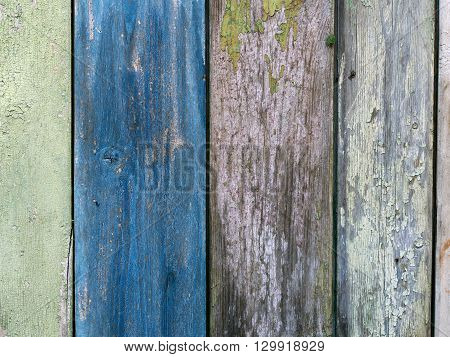 Boards farmhouse. Old boards, paint residues. Texture of wooden boards. Paint color - blue, green, gray, beige color