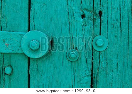 The Part of Aquamarin Old Vintage Door with Crack Paint and Big Steel Bolt with Screw and Nuts,TextureBackground