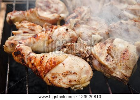 The is Grill Chiken Sticks on the Grid with Smoke,Fried Meet,Cooking Outside,Picnic with Barbecue