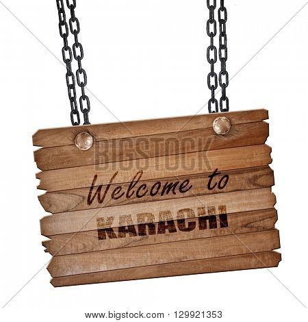 Welcome to karachi, 3D rendering, wooden board on a grunge chain