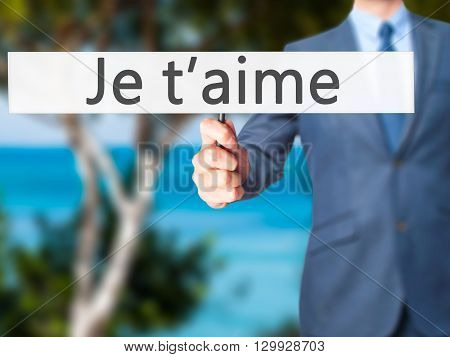 Je T'aime ( I Love You In French) - Businessman Hand Holding Sign