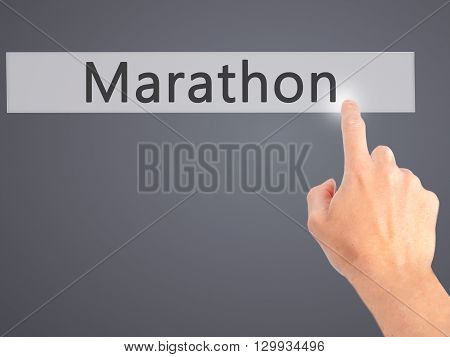 Marathon - Hand Pressing A Button On Blurred Background Concept On Visual Screen.