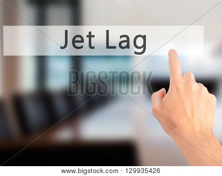 Jet Lag - Hand Pressing A Button On Blurred Background Concept On Visual Screen.