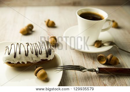 Cup of coffee and sweet buns on the table