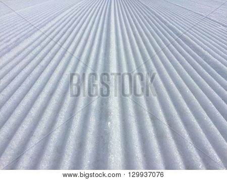 Snow grooves carved into the slopes ready for a fun day of skiing.