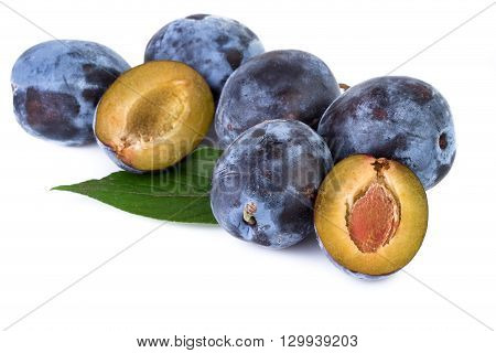 Organic plums with leaves isolated on white background. Closeup.