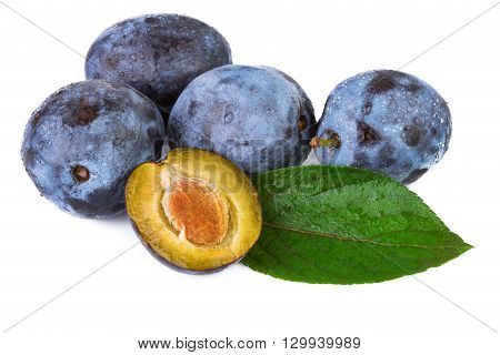 Fresh plums with water droplets on white background.