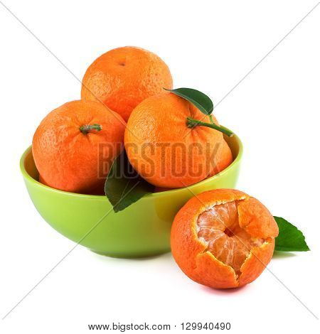 Mandarins fruit in green cup on white background.Organic fruits with leaves.