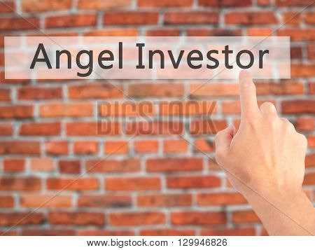 Angel Investor - Hand Pressing A Button On Blurred Background Concept On Visual Screen.