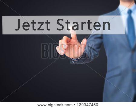 Jetzt Starten (start Now In German)  - Businessman Hand Pressing Button On Touch Screen Interface.