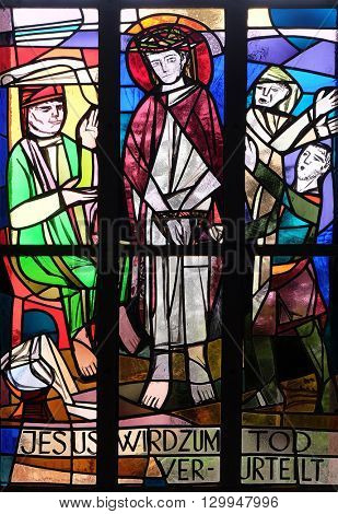 KLEINOSTHEIM, GERMANY - JUNE 08: 1st Stations of the Cross, Jesus is condemned to death, stained glass window in Saint Lawrence church in Kleinostheim, Germany on June 08, 2015.