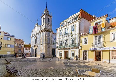 Seixal, Portugal. January 30, 2015: Seixal City Hall square, with the City Hall in centre and the Seixal baroque church on the left.