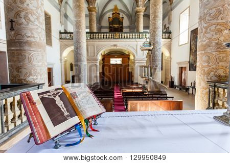 Santarem, Portugal. September 11, 2015: Open Bible over the altar in Misericordia church. 16th century Hall-Church in late Renaissance Architecture.