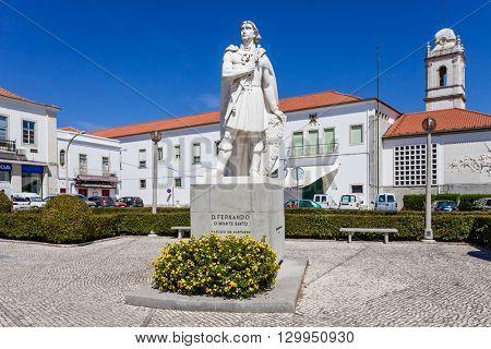 Santarem, Portugal. September 11, 2015:  Infante Santo Statue. In background, the Escola Pratica de Cavalaria, a military cavalry quarter and the former Trindade Convent tower.