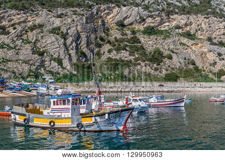 Sesimbra, Portugal. February 22, 2015: Traditional fishing boats at the fishing harbour of Sesimbra.