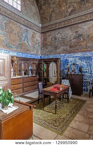 Santarem, Portugal. September 12, 2015: The Baroque sacristy with blue tiles and frescos painted in the walls and ceiling. Church of Santa Cruz. 13th century Gothic Architecture. Santarem, Portugal.