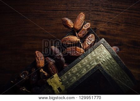 Fine quality Arabian dates stored in antique wooden trunk. Dates- The most popular and versatile fruit from the middle east and africa.