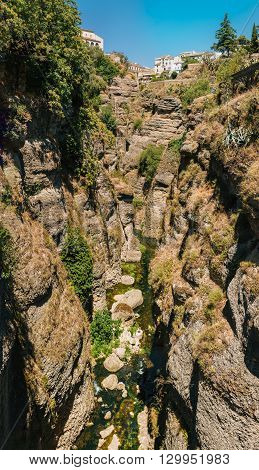 The Tajo De Ronda Is A Gorge Carved By The Guadalevin River, On Which The Town Of Ronda, Province Of Malaga, Spain