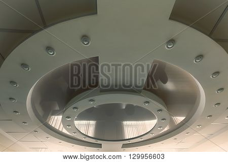 Modern layered ceiling with embedded lights and stretched ceiling inlay lights off