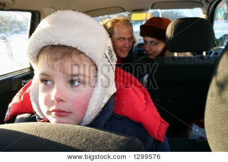 Sad Boy In Winter Family Car