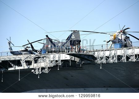 LAS VEGAS, USA - DECEMBER 23: Three old gombat helicopter standing on the deck of the aircraft carrier and museum ship MSS Midway in Navy Pier on December 25, 2015 at the Port of San Diego.