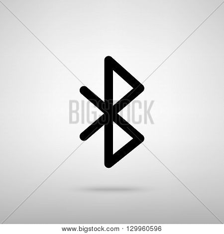 Bluetooth sign. Black with shadow on gray.