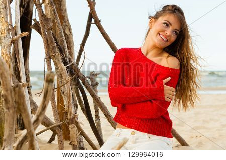 Rest and relax. Beauty young girl full of happiness spending time outdoor on seaside. Portrait of happy smiling woman on beach.
