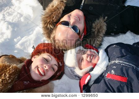 Winter Family Lies On Snow